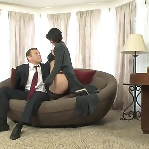Roxanne is blackmailed by her bosss son who fucks her in the office