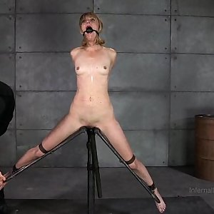 Slender Blonde In Device Restrain bondage
