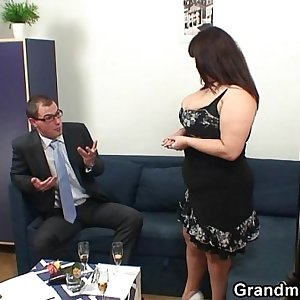 Fat titted woman takes two cocks