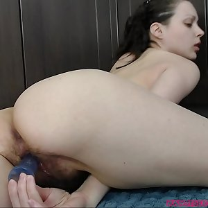 Girl fucking her hairy cunt with a fucktoy and frigs