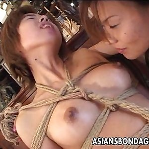 Bound Japanese cutie fingerblasted by a horny mistress