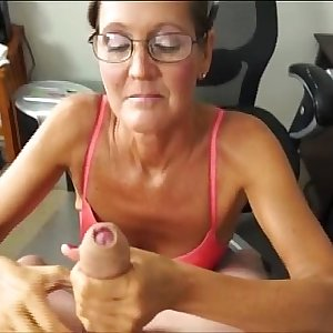 A Horny Mature Lady Sucks And Jerks